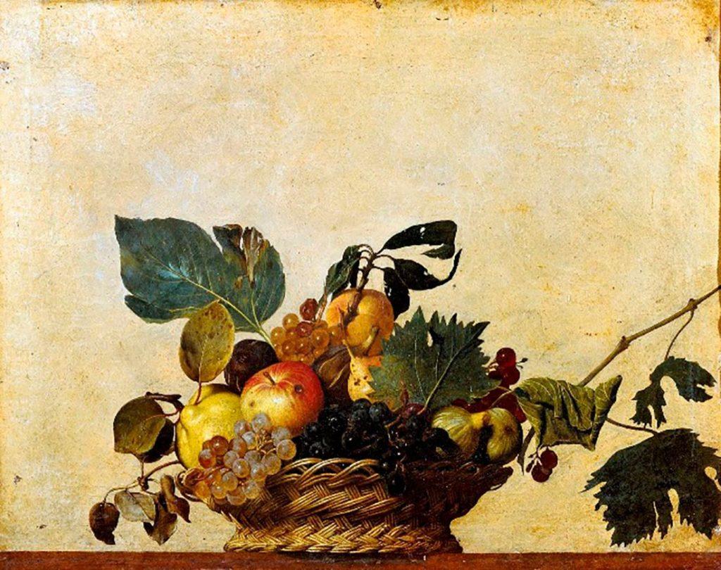 Cuadro de un bodegón de fruta con uva, manzanas, peras, higos, hojas de higuera sobre una cesta de mimbre. Poppyns Magazine