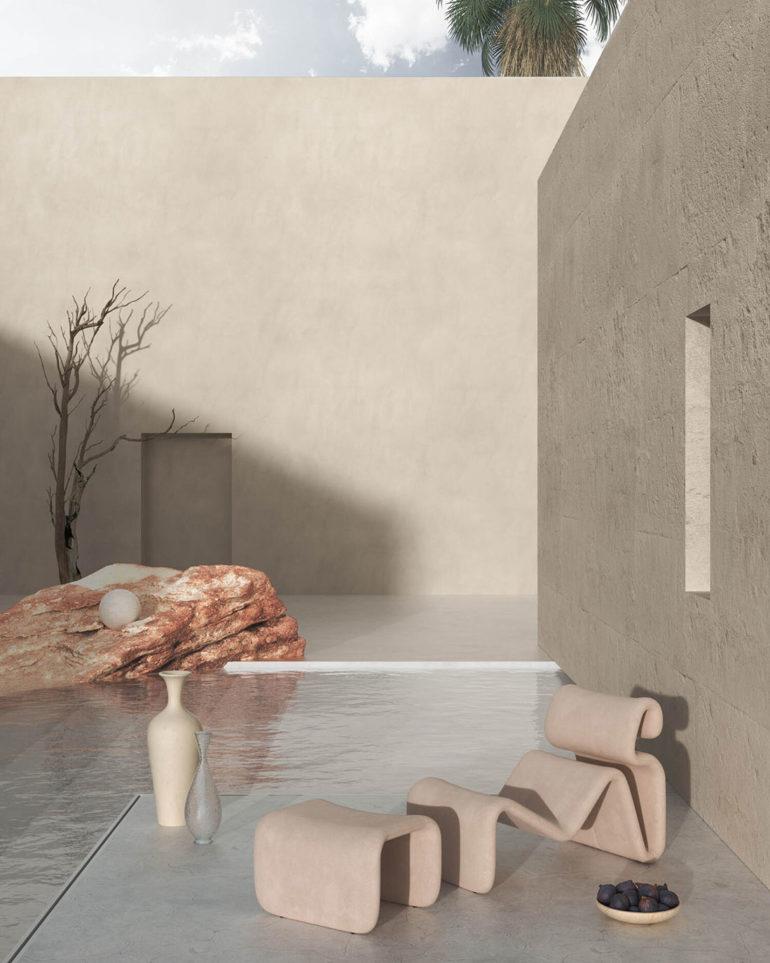 Terraza de un edificio minimalista con una chaise longue de piedra junto a un frutero, una piscina infinity, una roca roja y un árbol sin hojas. Poppyns Magazine